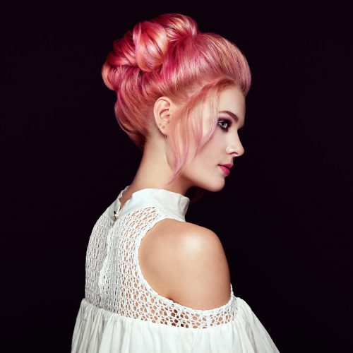 Blonde girl with elegant and shiny hairstyle. Beautiful Model Woman with Curly Dyed Hairstyle. Care and Beauty Hair products. Care and Beauty of Hair